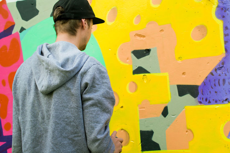 Casual Clothing Colorful EyeEm Best Shots EyeEm Gallery Graffiti Graffiti Art Graffiti Wall Guy Hands At Work Modern Modern Art Mural Mural Art Outdoor Photography Outdoors Painting People And Places Street Street Photography Young Youth Of Today