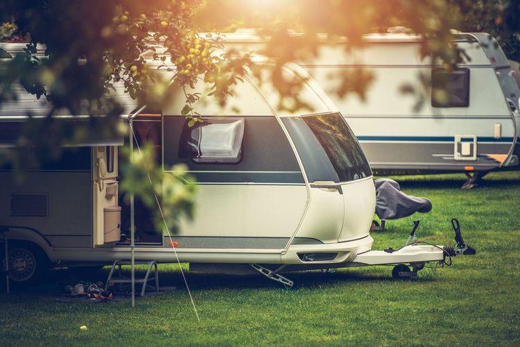 Motor home on grassy field in park