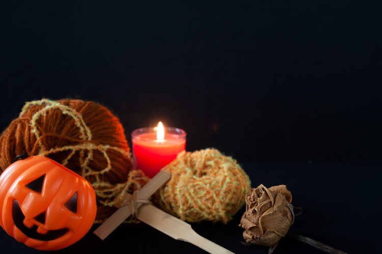 Halloween home decoration on black background Copy Space Halloween Holiday Horror Light October Black Background Burning Candle Celebration Close-up Copy Space Copy Space Over Ocean Dark Decoration Fire Night Orange Color Party Pumpkin Scary Still Life Studio Shot