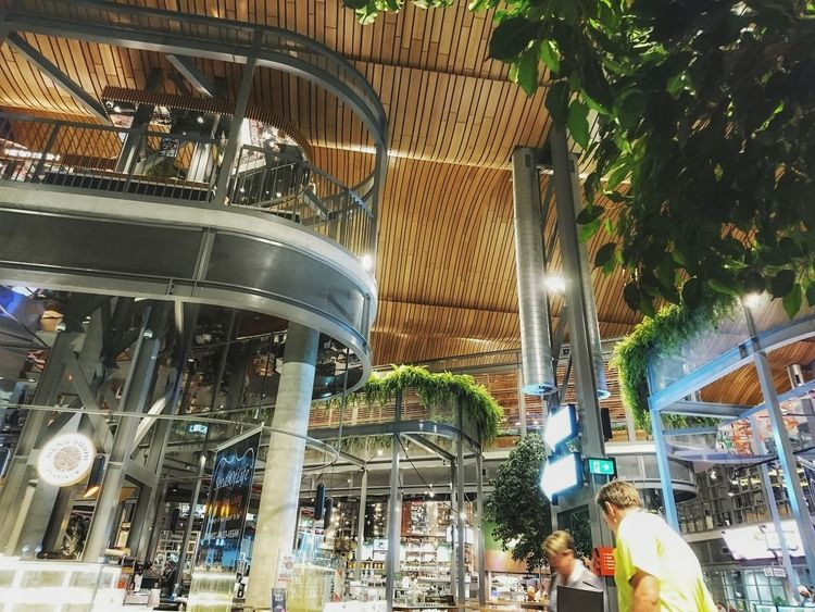 Built Structure Architecture Real People Tree People Crowd Hanging Plants Shopping Mall Modern Architecture.Food And Drink Restaurants Restaurant Decor Modern Modern Building Night Out Indoor Photography The Kitchen Foodie Heaven Glass Walls High Ceilings