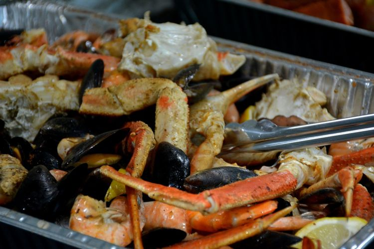 High angle view of seafood boil including crab legs