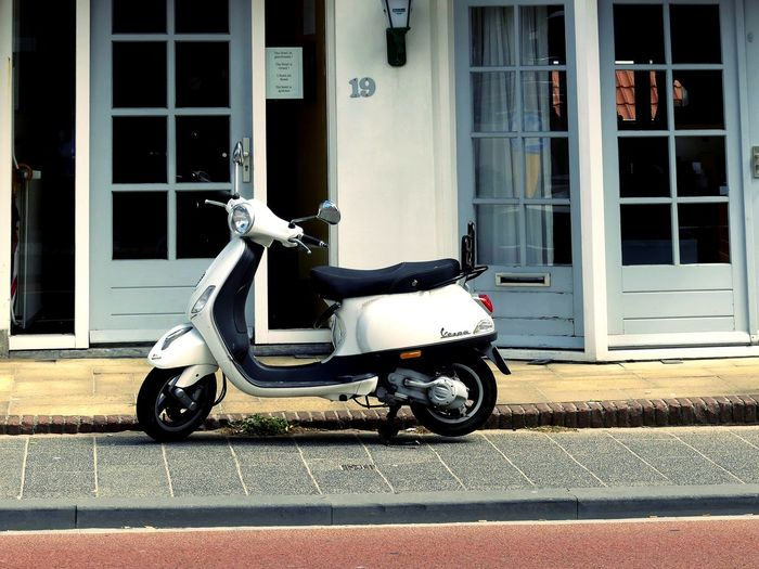 Side view of motor scooter parked on street