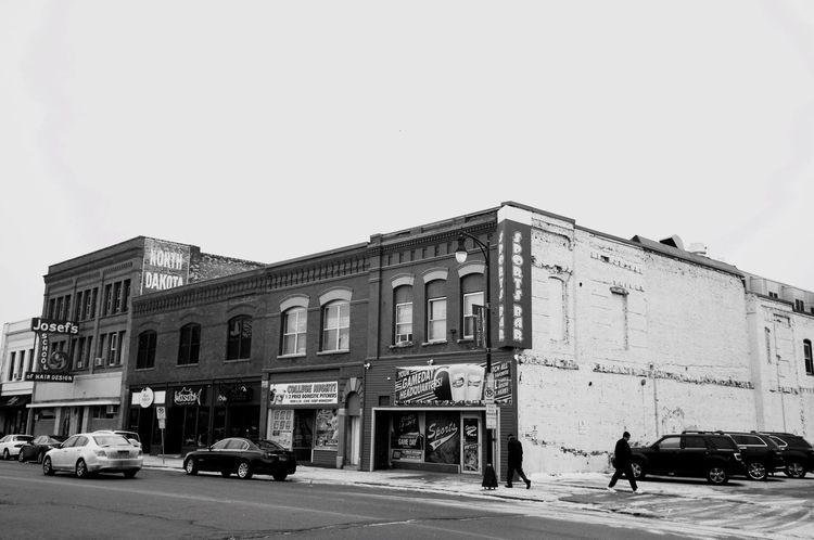 Architecture Building Building Exterior Built Structure City City Life Communication Exterior Fargo Historic Men Narrow Night Non-western Script North Dakota Outdoors Street Text Urban Western Script Women