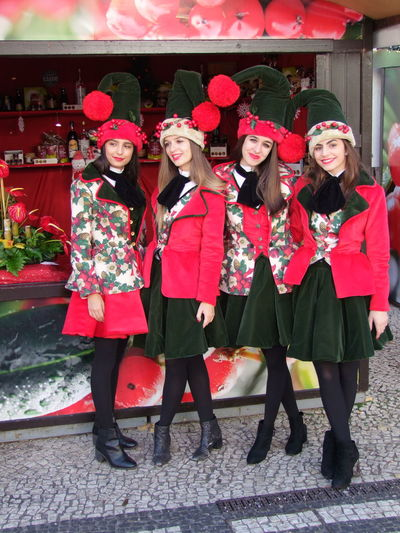 Four Young Women in Christmas Dresses, Avenida Arriaga Christmas City Composition Funchal Happy Madeira Portugal Cheerful Christmas Dress Christmas Hats Four Young Women Front View Full Frame Full Length Happiness Leisure Activity Looking At Camera Outdoor Photography Portrait Real People Red And Black Colour Smiling Standing Togetherness Young Women