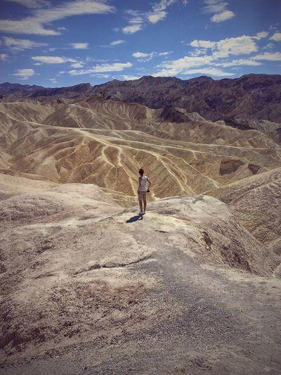 Man standing on arid landscape