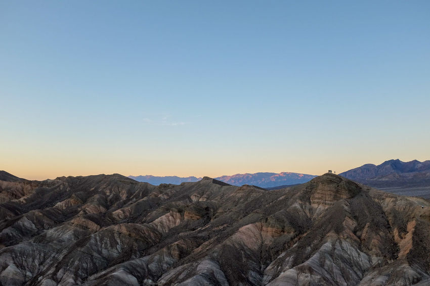 Mountain Scenics - Nature Beauty In Nature Mountain Range Non-urban Scene Rock Environment Clear Sky Arid Climate Formation Top To The Top Ascension Hikers Summit Sunset Death Valley