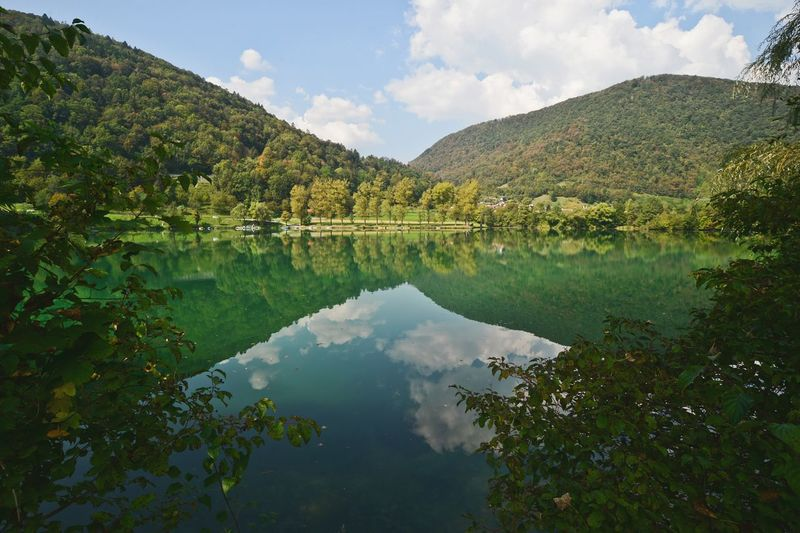 Water Reflection Lake Beauty In Nature Mountain Growth Nature Idyllic Travel Destinations Cloud Green Color Waterfront Sky Tourism Our Best Pics Popular Photos Slovenia Most Na Soci EyeEm Best Shots Soca River Isonzo My Favorite Place light and reflection Miles Away Live For The Story