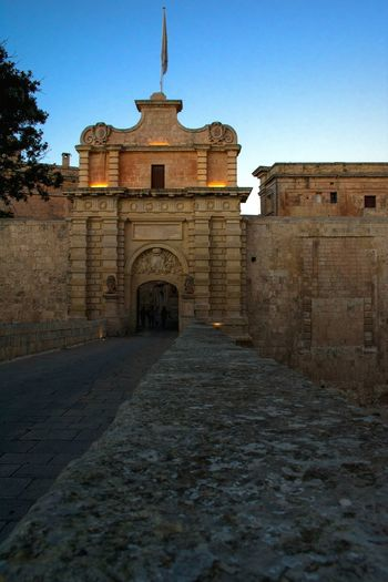 Mdina Gates Clear Sky History Business Finance And Industry Religion Architecture Building Exterior Sky Built Structure Ancient Rome Archaeology Amphitheater Ancient Egyptian Culture Ancient Civilization Civilization Tomb Old Ruin Pilgrimage Mausoleum Ruined Temple Bad Condition Bas Relief Athens Cambodian Culture Ancient History Mayan Run-down Deterioration The Past Weathered Egyptian Culture