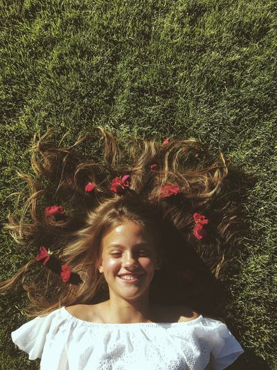 Portrait of happy woman lying on grass
