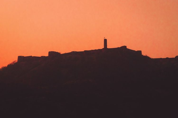 Jaigarh fort Sunset Sky Orange Color Silhouette Architecture Built Structure Nature Building Exterior People Beauty In Nature Scenics - Nature Tower Leisure Activity Land Outdoors Travel Travel Destinations Copy Space Building Clear Sky