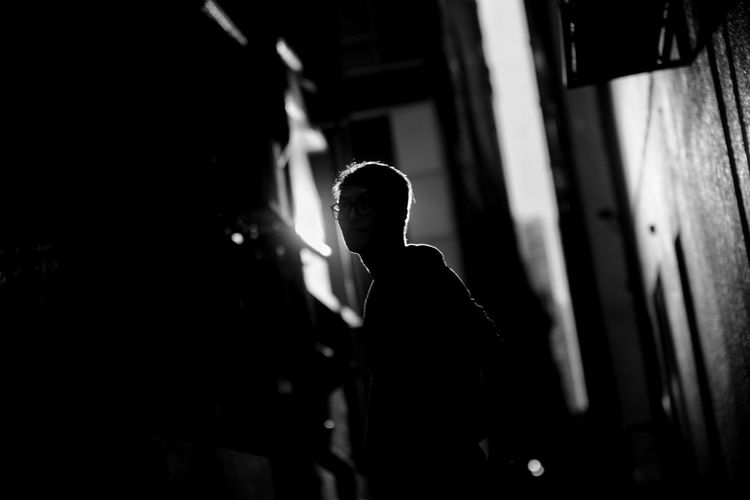 Silhouette of man standing at night