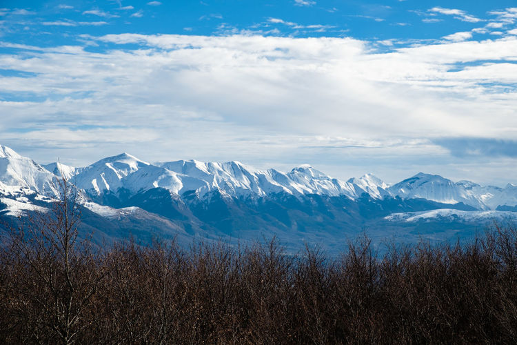Scenic view of snowcapped mountains against sky in accumoli, lazio italy