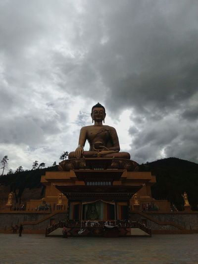 Cloud - Sky Architecture Place Of Worship Built Structure Sky Religion Belief History Building Exterior Sculpture Building Travel Destinations Spirituality Statue The Past Overcast Ancient Outdoors Bhutanese Culture Bhutanese Bhutan Thimphu Traditional Bhutanese Architecture Buddha Buddhism The Architect - 2018 EyeEm Awards