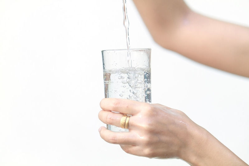Adult Adults Only Carbonated Close-up Cold Drink Cold Temperature Day Drink Drinking Drinking Glass Drinking Water Food And Drink Holding Human Body Part Human Hand Ice One Person People Purity Refreshment Water