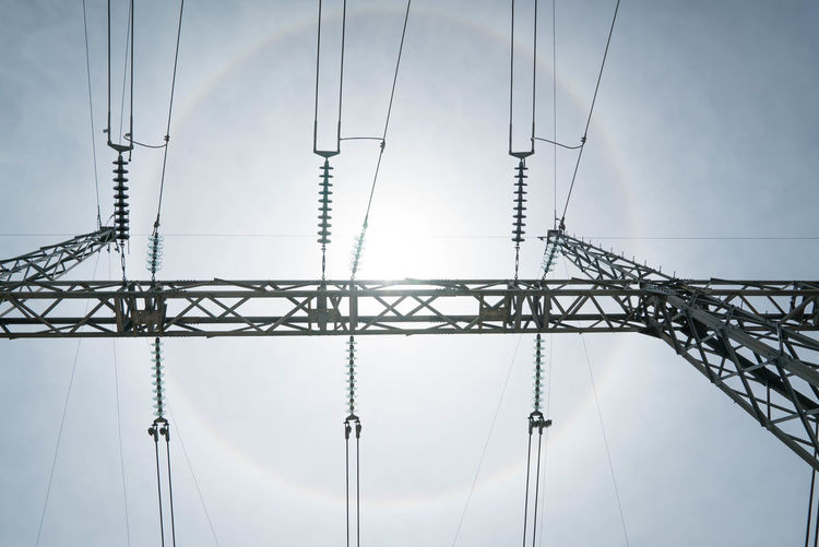 Transmission Power Line tower Pylon Cable Cloud Cloud - Sky Connection Day Development Electricity  Electricity Pylon Electricity Tower Fuel And Power Generation Long Low Angle View No People Power Line  Power Supply Sky Tall Tall - High Technology