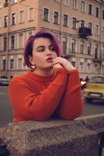 Portrait of beautiful woman in city