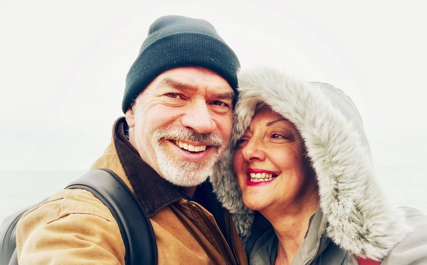 Portrait of smiling man and woman in winter