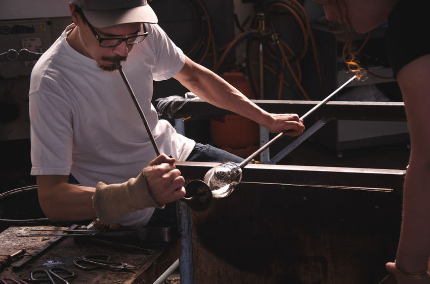 Adult Adults Only Berlin Glas Business Finance And Industry Craftsmanship  Expertise Glass Blowing Glass Studio Hand Made Glass Indoors  Manual Worker Manufacturing Men Occupation People Teamwork Work Tool Working Workshop Young Adult Business Stories