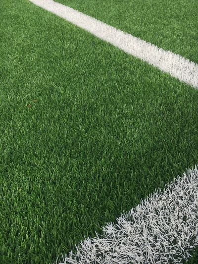 High angle view of white line on soccer field