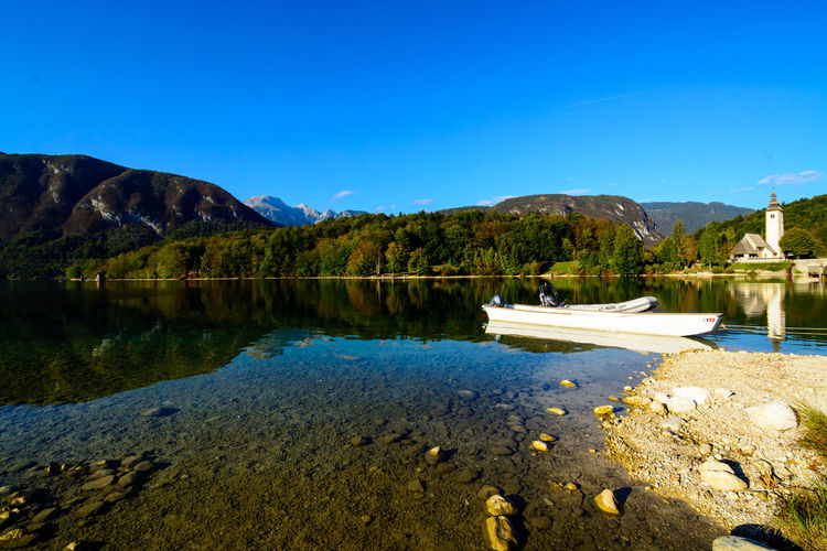Nature Sky Day Bohinjsko Jezero Water Lake Scenics - Nature Mountain Tranquility Beauty In Nature Tranquil Scene Reflection Clear Sky Blue No People Non-urban Scene Mountain Range Copy Space Idyllic Tree Outdoors