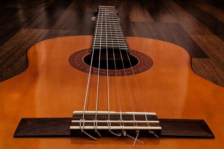 High angle view of acoustic guitar on table