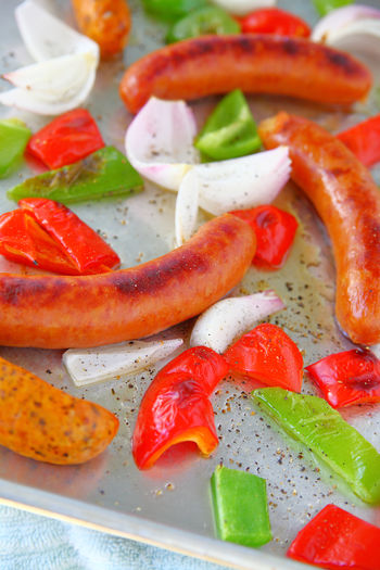 Sheet pan sausage and vegetables meal Black Pepper Home Cooking Homemade Food Natural Light Pork Sausages Balanced Meal Bell Peppers Close-up Colorful Indoors  No People One Pan Meal Onions Overhead Ready-to-eat Red Savory Food Sheet Pan Dinner Studio Shot Supper Vertical