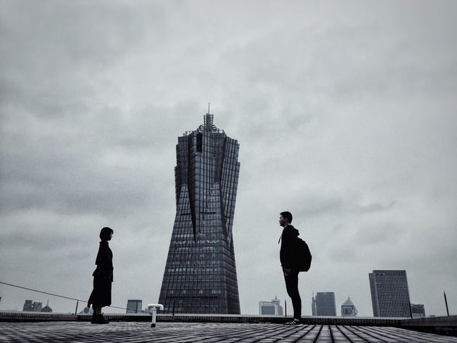 Sky Sky And Clouds Architecture Built Structure The Architect - 2016 EyeEm Awards Outdoors Tower Standing Low Angle View The Other Side Face To Face Quarrel Argument Monochrome Real People Love And Hate Roof Rooftop Storytelling Breakup