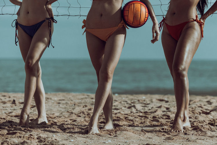 Low section of women on beach