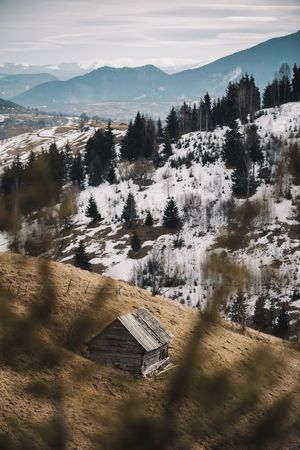 Green Color Mountain View Nature Wood Architecture Beauty In Nature Building Exterior Built Structure Cabin Cold Temperature Day Landscape Mountain Mountain Range Mountains Nature No People Outdoors Scenics Sky Snow Tranquil Scene Tranquility Tree Winter