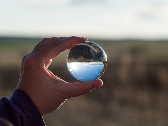 Crystal Ball EyeEm Best Shots EyeEm New Here Landscape_Collection Magnificent Nature Sphere Sphere Glass World In My Hands Ball Ball Reflection Concept Crystal Reflections Environment Hand Holding Human Body Part Human Hand Landscape Lifestyles Personal Perspective Real People Rural Scene Scenics Unrecognizable Person