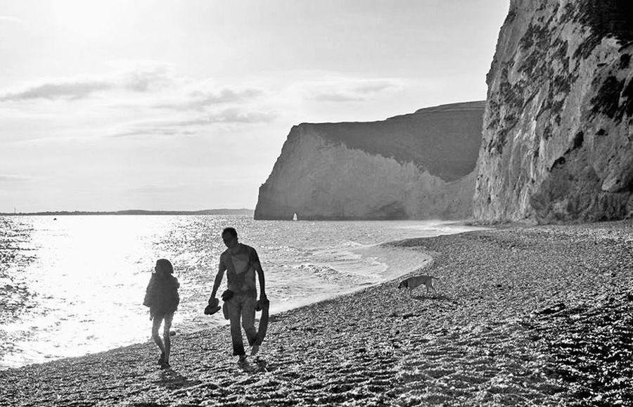 couple walking Beach Cliffs Clifside Couple Walking Dorset Durdle Door, Dorset Seascape Sunset Sunset Silhouettes Towards Portland