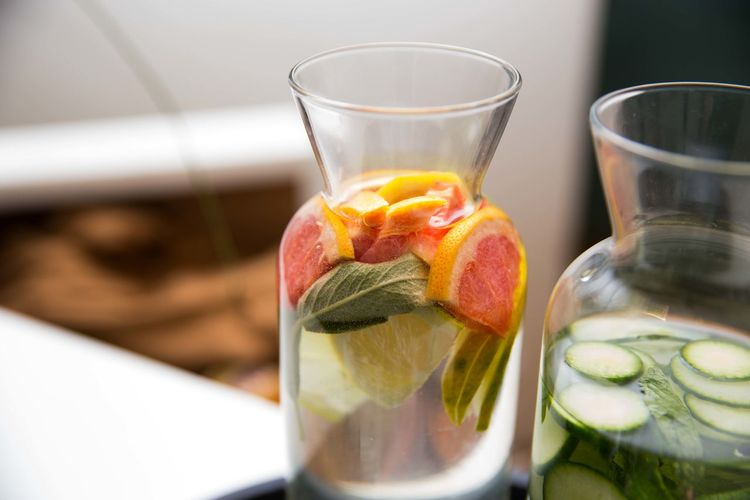 Jar with grapefruit and cucumber slices
