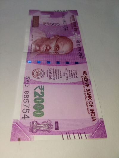 Indian two thousand rupee note 2000 Banknote Business Close-up Currency Currency Indian Day Finance Finance And Economy Indian Culture  Indian Currency Indian Two Thousand Rupee Note Indoors  New No People Paper Currency Pink Color Savings Success Two Thousand Rupee Note Wealth