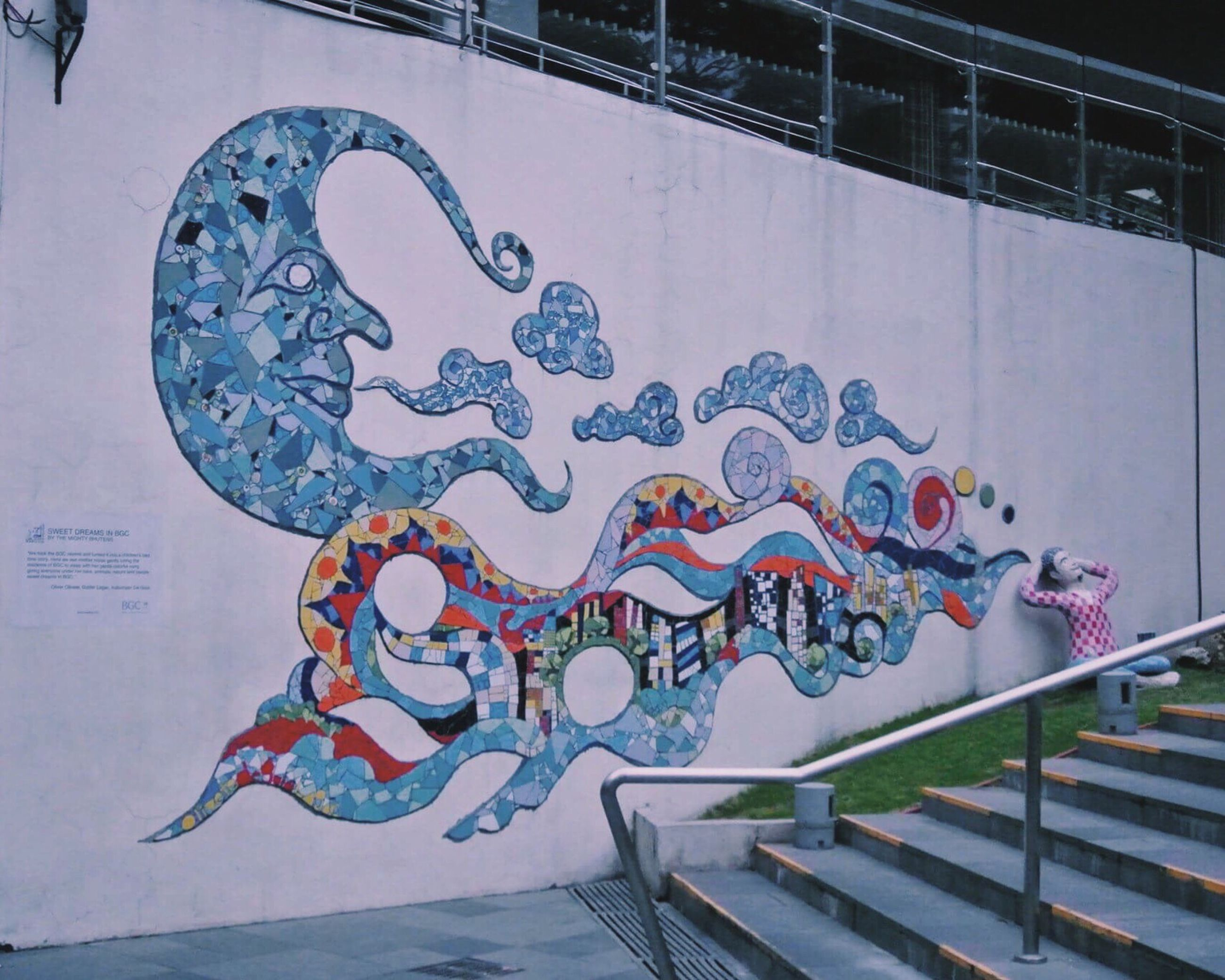 art, art and craft, creativity, graffiti, built structure, architecture, human representation, animal representation, wall - building feature, text, street art, building exterior, craft, sculpture, railing, multi colored, day, no people