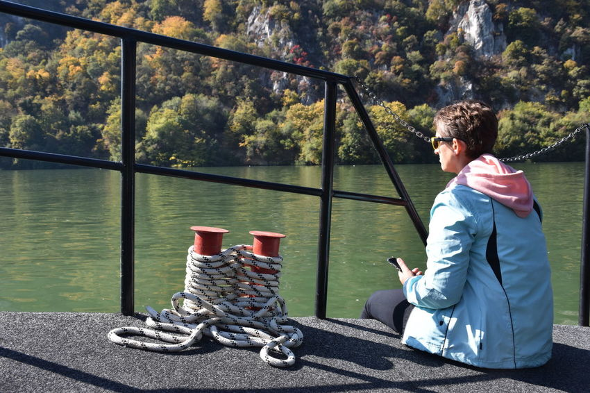 Danube gorge, Serbia Water One Person Real People Nature Day Casual Clothing Sitting Lifestyles Leisure Activity Sunlight Side View Transportation Outdoors Tree River Ship Nautical Vessel Woman Mature Adult