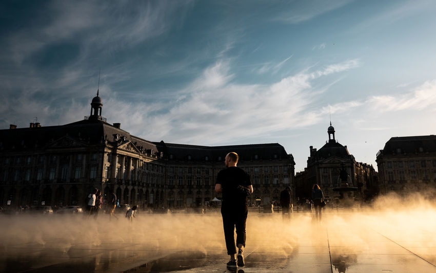 Beautiful sundown at Miroir d'Eau, Bordeaux, France. Bordeaux City France Gold Kids Miroir D'eau - Bordeaux Sunlight Travel Travel Photography Blue Sky Day Fog Fujifilm Fujifilm_xseries Golden Hour History Playing Shadow Silhouette Street Street Photography Streetphotography Sundown Sunset Water