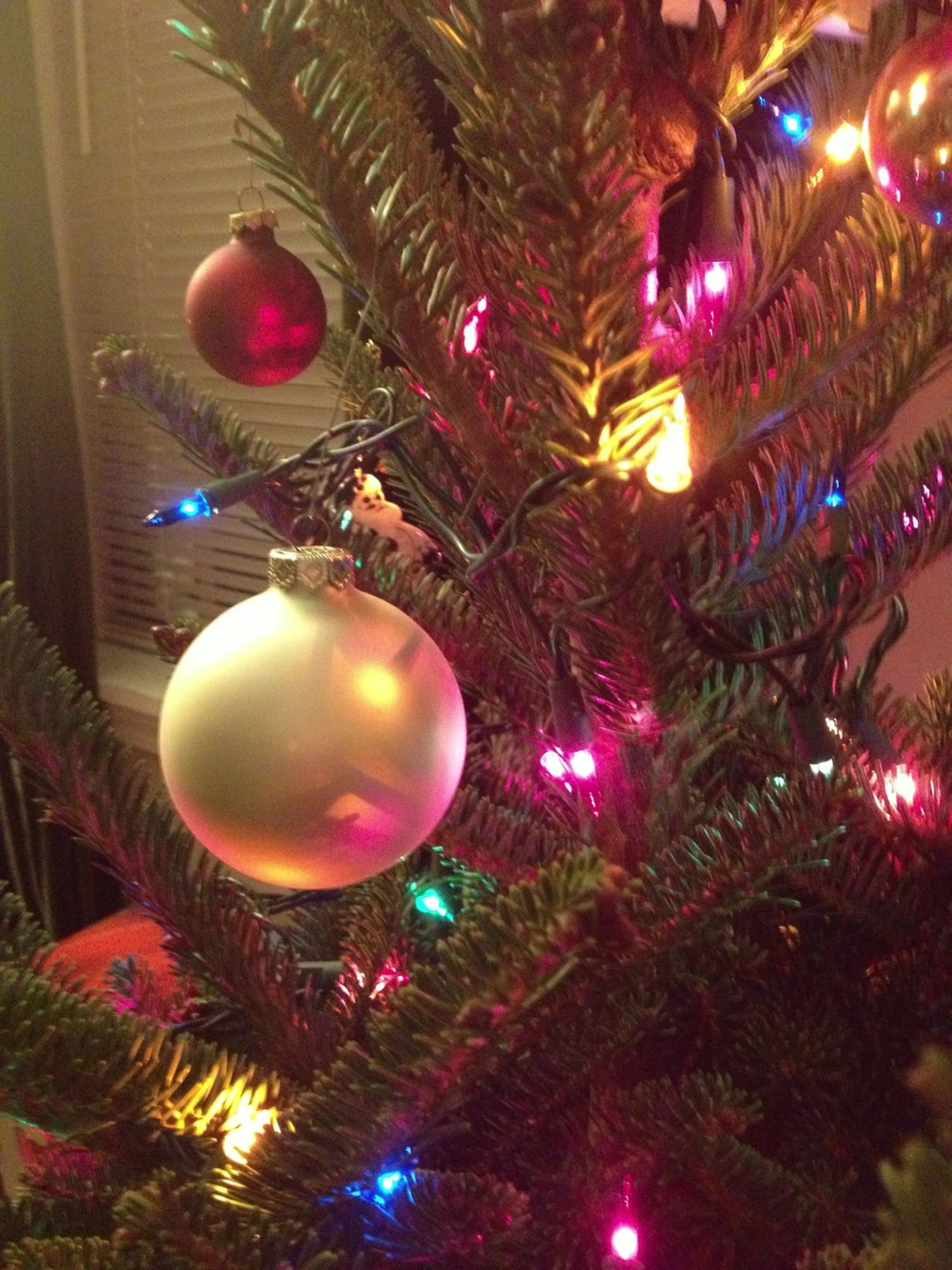 christmas, celebration, illuminated, christmas decoration, christmas tree, christmas ornament, decoration, christmas lights, hanging, lighting equipment, tradition, holiday - event, low angle view, decor, indoors, night, celebration event, traditional festival, multi colored, sphere