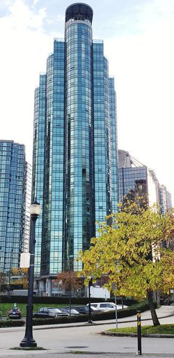 tower of glass Cityscape Office Life Vancouver Canada Downtown Downtown District Downtown Vancouver Glass Building Glass Building Window Reflection City Cityscape Tree Modern Skyscraper Urban Skyline Office Sky Architecture Building Exterior Office Park Office Building Exterior Tall - High Office Building