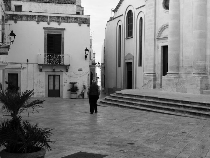 Architecture Built Structure Building Exterior Real People One Man Only Walking Outdoors One Person Lifestyles Locorotondo Italy Italia Italy🇮🇹 No Filter No Filter Needed No Filter, No Edit, Just Photography Blackandwhite Black And White Blackandwhite Photography Black And White Photography Black & White