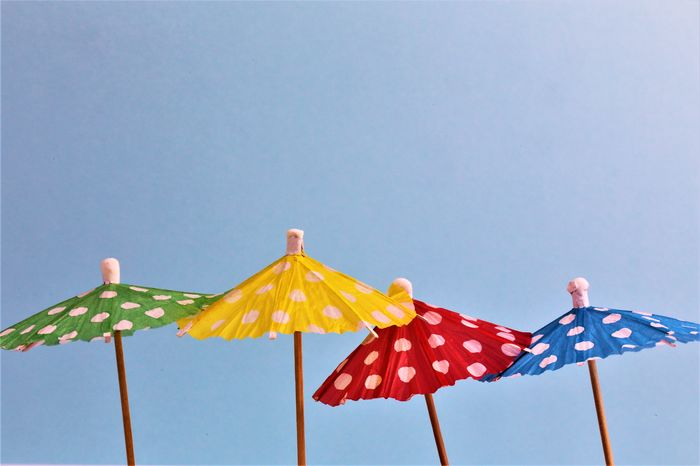 An concept Image of some umbrellas with a colorful Background and copy space Business Coctails Copy Space Drinks Office Abstract Background Close-up Coctail Colorful Concept Day Decoration Decorations Drink Multi Colored No People Umbrella Umbrellas