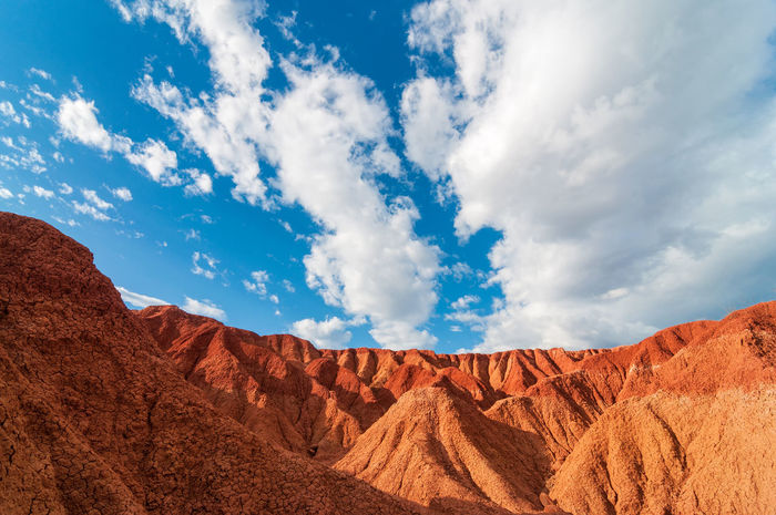 Red Tatacoa Desert in Colombia under a nice blue sky Arid Clouds Colombia Desert Desolate Desolated Drought Dry Environment Heat Hot Huila  Land Landscape Nature Neiva Outdoors Scenery Scenic Sunny Tatacoa Travel View Waterless Wilderness