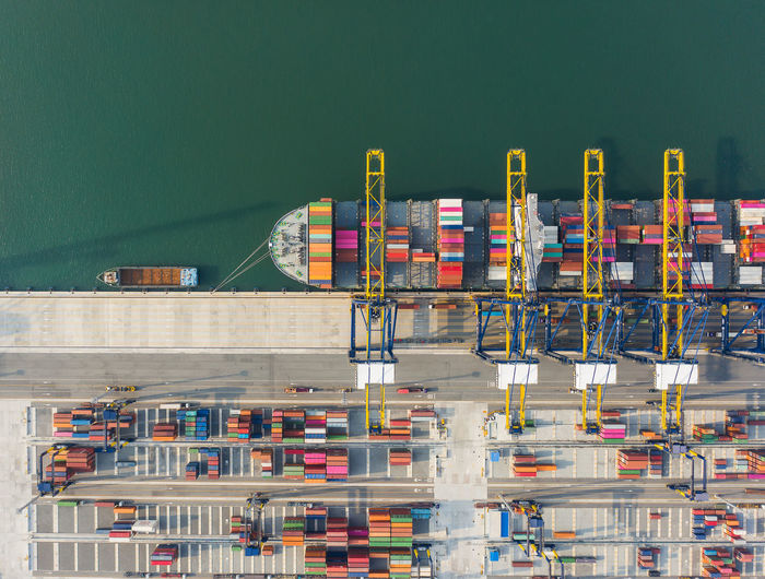 Aerial view of container ship moored at harbor