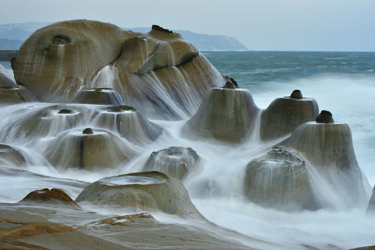 New Taipei City Wild Yehliu Geopark , famous candlelitstone, rock special, sprayed on the coast, forming a beautiful picture Magnificent Rock Spectacular Yehliu Geological Park Yehliu Geological State Park, Candlestick Stone Yehliu Geopark Beauty In Nature Day Horizon Over Water Long Exposure Motion Nature New Taipei City No People Outdoors Scenics Sea Sky Spray Water Waterfall Waves Wild Willow Yehliu Park