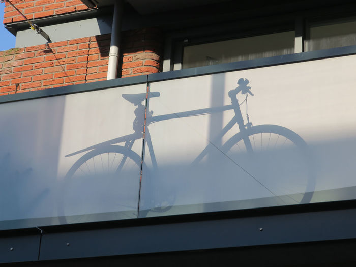 Low angle view of bicycle against building