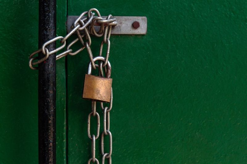 Copy Space Chain Emotion Mood Urban Scene Chain Metal Green Color No People Lock Safety Padlock Security Close-up Protection Hanging Closed Entrance Door Focus On Foreground Rusty Positive Emotion Closed Door Locked Attached Entry Link Gate Entryway Doorway