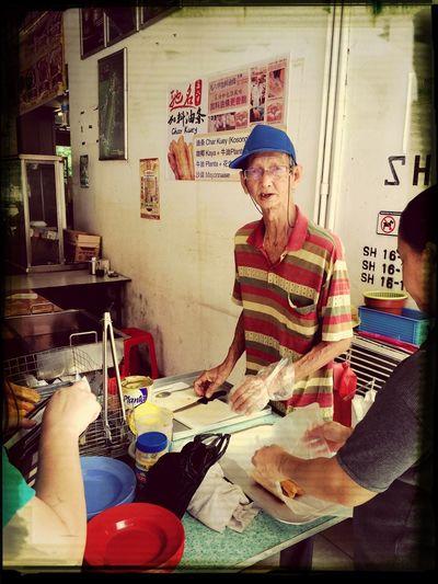 Char Kuey Seller Taking Photos Enjoying Life