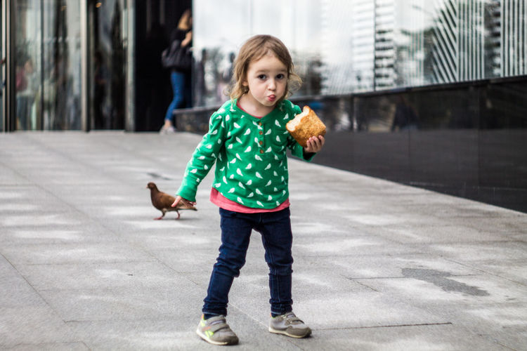 Architecture Casual Clothing Child Childhood City Day Focus On Foreground Footpath Full Length Girls Holding Innocence Looking At Camera Offspring One Person Outdoors Portrait Road Smiling Standing