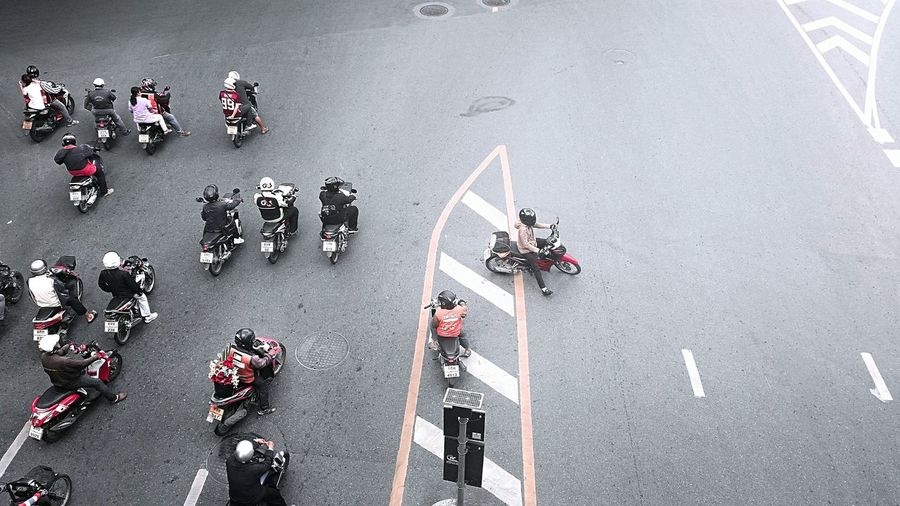 High Angle View Of Motorbikes On Road