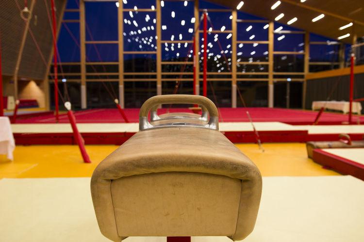 Close-up of empty seats in amusement park