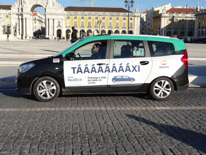a nice message on a taxi car... Lisbon - Portugal Taxi Commercial Sign Outdoors Taxi Commercial Text Transportation
